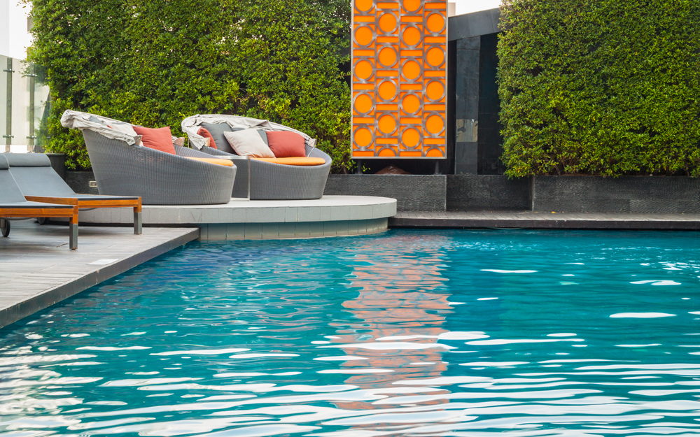 Outdoor space with swimming pool example that could be installed by Preston Greenhouse